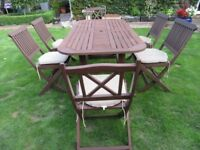 garden table and chairs PLUS CUSHIONS