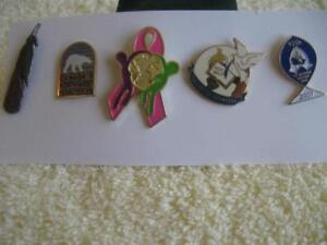 Four INTERESTING LAPEL PINS for the COLLECTOR...[MINT]