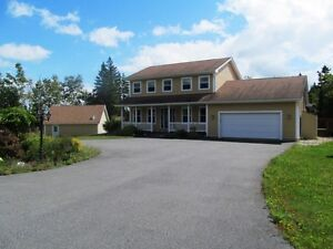 RARE- Family home with inlaw suite +a rental apt & (2) Garages!!