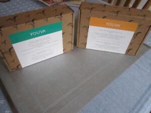 YOUVA Beauty Products... orange box has 2-pack Bright Eyes Cream
