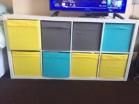 8 Kallax IKEA storage boxes for sale, 4 yellow, 2 blue and 2 grey. £8 for all.