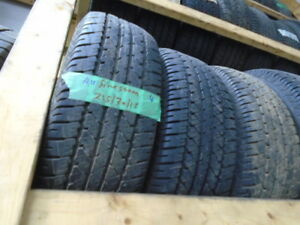 FOUR USED ALL SEASON TIRES  215-70-15 { FIRESTONE } R.H AUTO