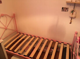 Lovely pink single sized bed as pictured in immaculate condition