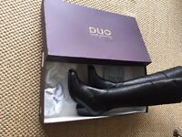 NEW: Duo black leather knee-high boots