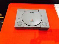 PLAYSTATION 1 WITH 12 MONTH WARRANTY THAT COVERS PLAYSTATION, WIRED CONTROLLER + ALL CABLES
