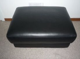 Large black leather footstool