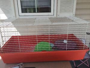 large animal cage, hide, dish, large wheel