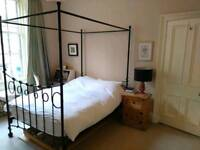Four poster wrought iron double bed
