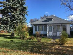 It's the Location! 2 BR home on large corner lot in Shoal Lake!