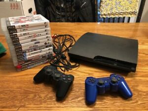 PS3 with 2 Controllers, and 13 Games