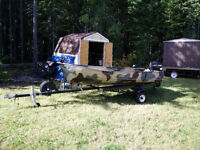 camo boat motor and trailer