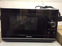 A Hotpoint black microwave