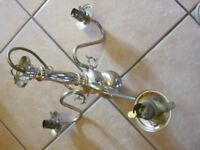 Brass ceiling light...... 3 globe holder with frosted globes