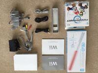 Wii bundle (11 games, light sabre, mario kart steering wheel) - US version with converter supplied