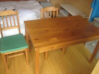 Wooden dining table and 4 chairs.