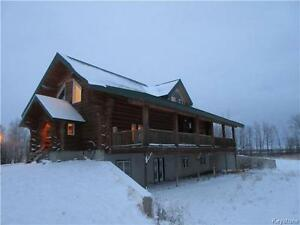 Country living in a 4 BR log home on 80 acres near Rossburn MB