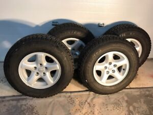 4 set of winter tires on jeep branded rims