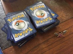 pokemon cards, pin and large deck boxes