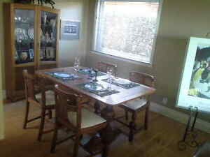 Antique dining room table,4 chairs and hutch