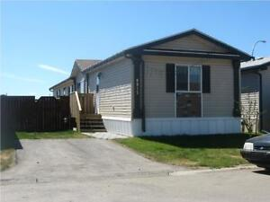WELL MAINTAINED 1217 SQ FT MOBILE LOCATED IN CREEKSIDE
