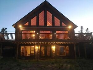 17-103 Fabulous log home on the ocean!! Spectacular location!