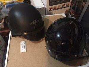 2 Black Motorcycle Helmets