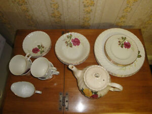 China set for 4 people, white with roses and gold edges