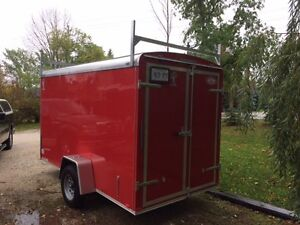 12 ft. New enclosed trailer w/Spare and ladder rack