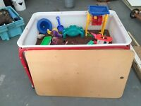 Sand or seed interactive table and toys