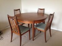 G Plan extending teak table & 4 chairs.