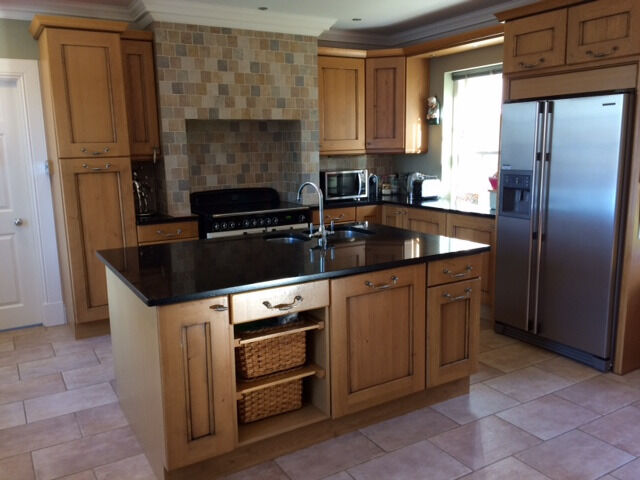 Solid Oak Kitchen With Black Sparkly Granite Worktops For