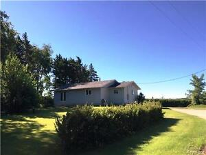Acreage with a 2BR home in a private setting near Rossburn MB