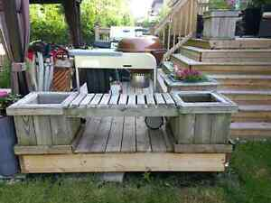 Bench with attached flower boxes