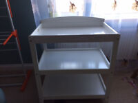 White changing table with two shelves