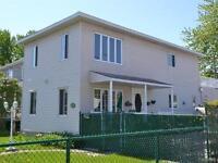 Grand cottage clé en main 51x21 à Laval-des-Rapides