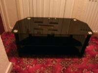 Tv stand in black glass, will take up to a 50'' tv, free to uplift.