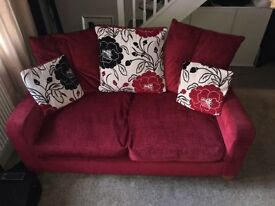 two seater sofa, red with scatter cushions, ,, selling as singles or as a pair