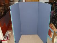 Three unused blue felt boards with white board on reverse
