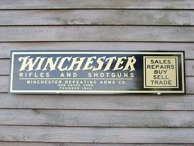 EARLY STYLE WINCHESTER RIFLES AND SHOTGUNS DEALER SIGN/AD 1'X4' ALUM. PANEL