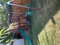 PLAY CENTER! Monkey bars, swings, slide and play house!!!