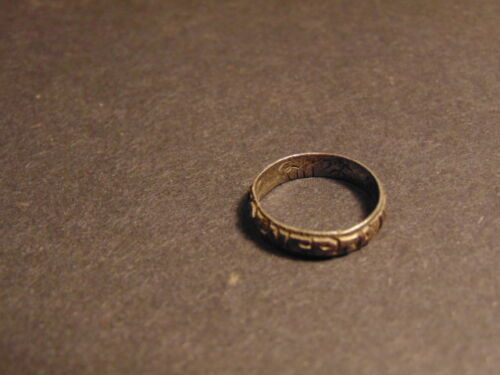 """vintage silver colored ring with """"ALMERTA"""" on face, inscribed inside band"""