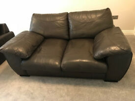 Pair of two seater leather sofas for sale.
