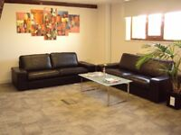 Office relocating. 2 x Black Leather Sofas 3 seater. Buyer collects. Sold Seperately