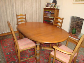 Ercol Oval solid built extending Dining table and 2 carver and 3 dining chairs