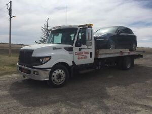 CANADIAN  TOWING BEST RATE Tilt Flat Bed Towing Since 1989