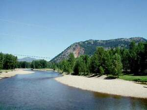 40 AC. RIVERFRONT; SANDY BEACH Paradise found