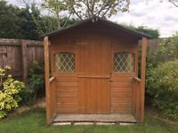 6ft by 6ft Wooden Playhouse with upstairs and verandah.