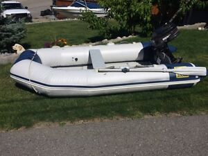 10 ft zodiak, with 5 hp Mercury 2 stroke