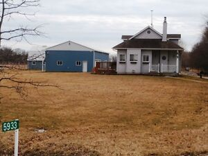 APPROX. 12.8 ACRES WITH HOME, BARN, OUTBUILDING, POND & BUSH