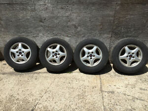 Four 15 inch Pontiac Montana Aluminum wheels,Michelin tires.